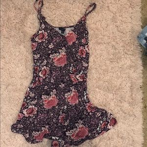 AE romper with pink and light purple flowers